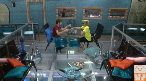 Steve Moses and Vanessa Rousso, houseguests from Big Brother 17, playing chess