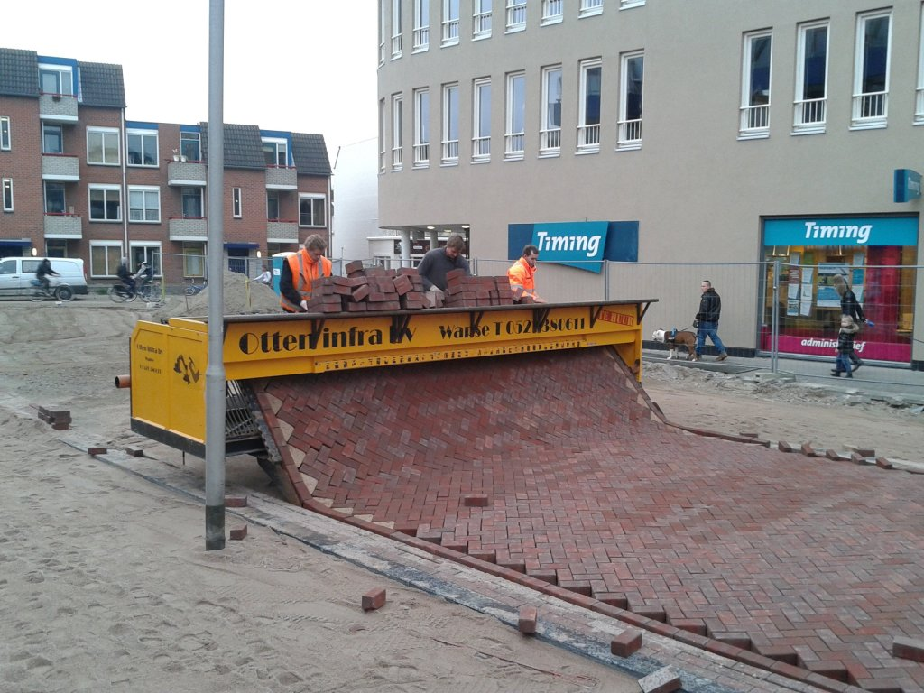 brick laying machine on European street